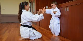a karate teacher with child